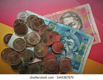 Ukrainian hryvnia. Ukrainian currency, small change, bill with metal money, ten and five hryvnia with one and two hryvnia coins. Close-up.