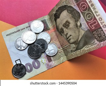 Ukrainian hryvnia. Ukrainian currency, small change, bill with metal money, one hundred hryvnia with one and two hryvnia coins. Close-up.