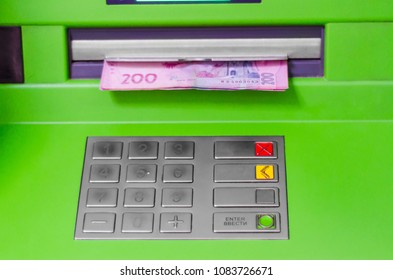 Ukrainian hryvnia in the window of the ATM
