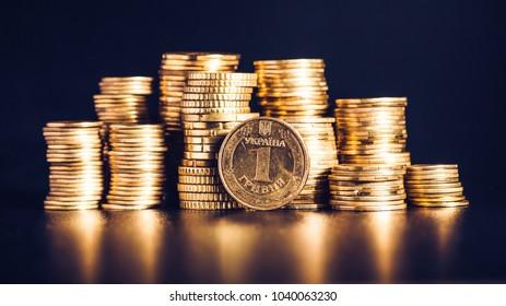 Ukrainian hryvnias, heap of coins/Ukrainian steel coin denominations of 1 hryvnia