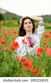 ukrainian lady in the field of poppies