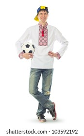 Ukrainian man in the national shirt with a ball on a white background