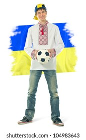 Ukrainian man in the national shirt with a ball and flag on a white background