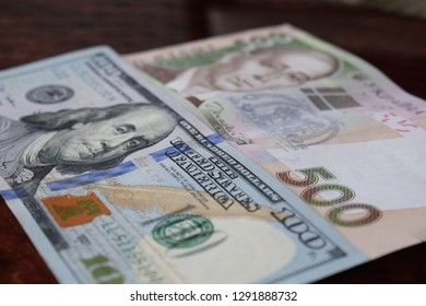 Ukrainian money - 500 hryvnia banknotes USA 100 dollars bills. Finance crisis in Ukraine, the fall of the hryvnia to the dollar exchange rate. Money background