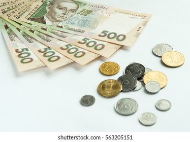 Ukrainian money - coins and hryvnia on a light background.