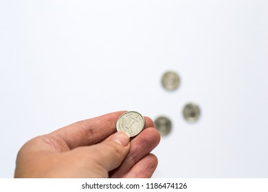 Ukrainian money hryvnia in hand isolated on white background. Inflation, business. econimics and finance theme.