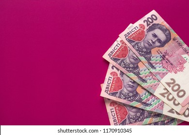 Ukrainian money isolated on pink background. Banknotes of 200 UAH (hryvnia). Inflation, business. econimics and finance theme. Problem of rise of prises of gas and electricity  in Ukraine. - Shutterstock ID 1170910345