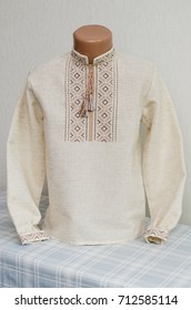 Ukrainian national clothes in the form of a tradicional embroidered shirt. Selective focus.