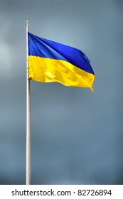 ukrainian national flag against the blue sky