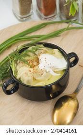 Ukrainian pelmeni soup with spices