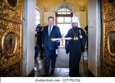 Ukrainian President Petro Poroshenko(L) and Metropolitan Epifaniy(R), head of Ukrainian Orthodox Church, carry the Tomos decree before Christmas service in St.Sophia Cathedral. Kyiv,Ukraine.07-01-2019
