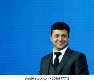 Ukrainian Presidential candidate Volodymyr Zelensky smiles on blue background during a debate with Petro Poroshenko at NSC Olimpiyskiy Stadium in Kiev, Ukraine, 19 April 2019.