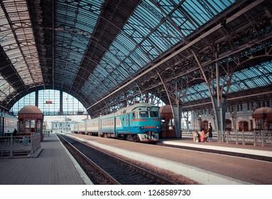 Ukrainian railways old diesel passenger train staying at station. Lviv, Ukraine.