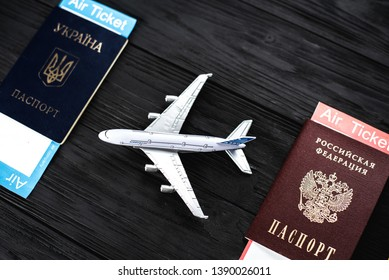 Ukrainian and Russian passports, rails and model aircraft. The concept of passenger traffic between Ukraine and Russia