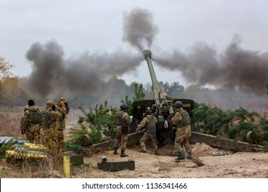 Ukrainian servicemen fire a 2A65 Msta-B howitzer during military exercises near the village of Divychky in Kiev region, Ukraine, October 21, 2016