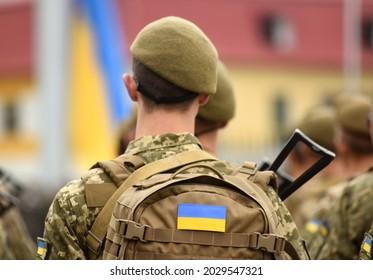 Ukrainian soldier. Ukrainian in army. Ukrainian flag on military uniform. Troops of Ukraine.