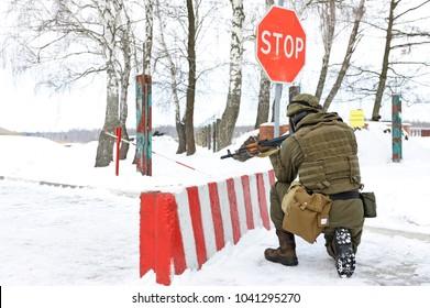 Ukrainian soldier took position guarding roadblock. National guard of Ukraine exercises, military range. Press-tour for mass-media. February 1, 2018. Novo-Petrivtsi, Ukraine