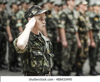 Ukrainian soldiers. A soldier salutes an officer