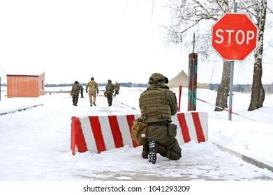 Ukrainian soldiers took position guarding roadblock. National guard of Ukraine exercises, military range. Press-tour for mass-media. February 1, 2018. Novo-Petrivtsi, Ukraine