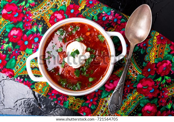 Ukrainian traditional borsch. Russian vegetarian red soup  in white bowl on black background. Top view.  Borscht, borshch with beet