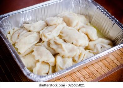 Ukrainian varenyky perogies in foil plate