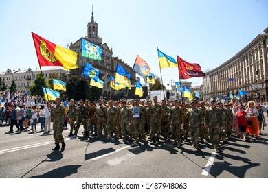Ukrainian veterans of war on Eastern Ukraine, volunteers and relatives of soldiers, who killed on war on Eastern Ukraine  during march on Independence Day in  Kyiv, Ukraine, 24 August 2019.