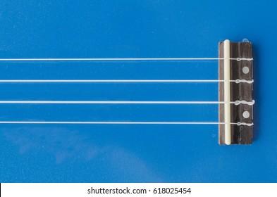 ukulele , guitar, saddle, strings, bridge.
