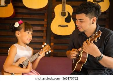 Ukulele Guitar teacher teach music in school