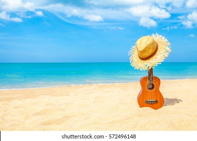 Ukulele on the beautiful summer beach wiht copy space