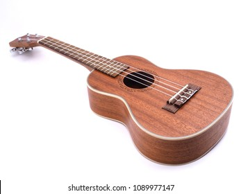 A ukulele on green lawn background with copy space.