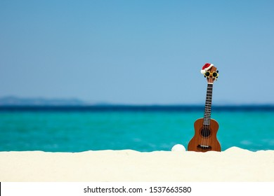 ukulele on the sand by the sea in summer nearthe beach