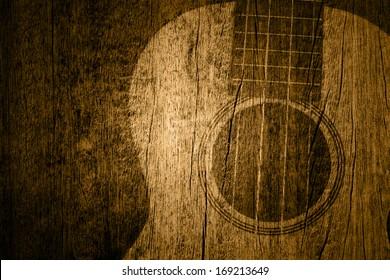Ukulele in wood texture background