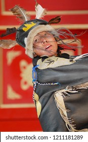 Ulaanbaatar, Mongolia - August 16, 2006: Unidentified young man wearing shaman's costume performs traditional ceremony in Ulaanbaatar, Mongolia.