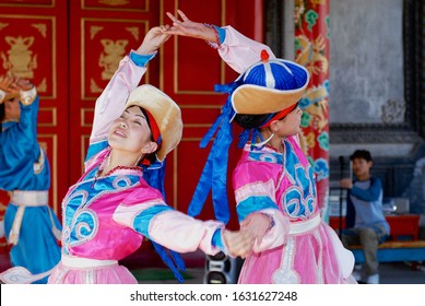 Ulaanbaatar, Mongolia - August 16, 2006: People wearing traditional costumes perform traditional dance in Ulaanbaatar, Mongolia.
