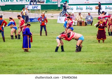 ULAANBAATAR, MONGOLIA - JULY 11, 2010: Wrestlers compete in Ulaanbaatar stadium on first day of Nadaam the most important festival of the year. Competitions include horse racing, wrestling and archery