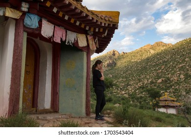 Ulaanbaatar, Mongolia - July 16, 2014 : A Mongolian young woman praying in a remote Buddhist temple on the mountains, in Mongolia.