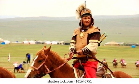 ULAANBAATAR, MONGOLIA - JULY 2013: Naadam Festival Horse Archery Crew with horse and traditional medieval outfit, posing