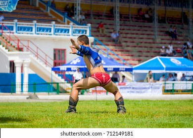 Ulaanbaatar, Mongolia - June 11, 2007: Winning wrestler celebrating with traditional eagle dance inside the National Sports Stadium after a Naadam Festival wrestling match