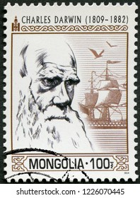 ULAANBAATAR, MONGOLIA - MARCH 25, 2014: A stamp printed in Mongolia hows portrait Charles Darwin (1809-1882), 2014