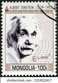 ULAANBAATAR, MONGOLIA - MARCH 25, 2014: A stamp printed in Mongolia shows portrait shows shows Albert Einstein (1879-1955), physicist, 2014