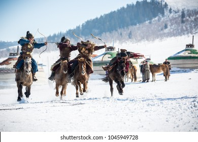 ULAANBAATAR, MONGOLIA - MARCH 5 2018 :master skill for mongolian archery aim single target while riding horseback.traditional show in golden eagle festival winter