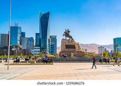 ULAANBAATAR, MONGOLIA - OCTOBER 3, 2018 : Sukhbaatar Square or Genghis Khan Square with the Statue of Mongolian revolutionary hero Sukhbaatar and the cityscape of Ulaanbaatar in Mongolia