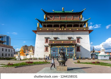 Ulaanbaatar, Mongolia - Sept 10th 2018 - The Gandantegchinlen Monastery in the suburbs of Ulaanbaatar in a blue sky day and some tourists around it in Mongolia