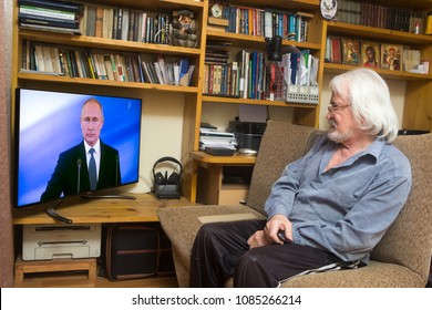 ULAN - UDE, RUSSIA - MAY 07, 2018: Russian pensioners look at the inauguration of Russian President Vladimir Putin on TV in his old apartment.