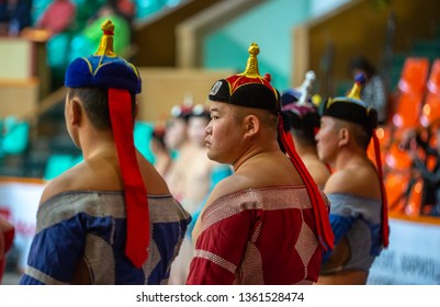 Ulannbaatar, Mongolia, 27th September 2015: mongolian wrestlers in traditional hats and clothing lined up for a practice session