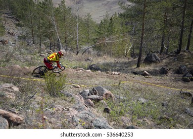 """Ulan-Ude, Russia - April 27: unidentified racer overcomes the jump on the competition for the """"Cup of Buryatia on a Mountain Bike"""" on 27 April 2014 in Ulan-Ude, Russia."""