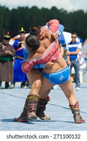 ULAN-UDE, RUSSIA - JULY 17, 2010: Two unidentified men compete in Mongolian national wrestling in heavy weight during the 4th General Session of the World Mongolians Convention.