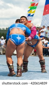 ULAN-UDE, RUSSIA - JULY 17, 2010: Two unidentified Mongolian heavy weight wrestlers fight in national wrestling during the 4th General Session of the World Mongolians Convention.