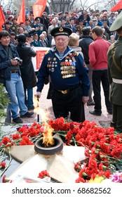 ULAN-UDE, RUSSIA - MAY 9: An elder seaman veteran looks with sorrow at eternal flame on annual Victory Day, May, 9, 2009 in Ulan-Ude, Buryatia, Russia.