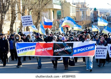 ULAN-UDE, RUSSIA - NOVEMBER 1: Townspeople (30% of  them belong to Asians) protest against a number of murders in Moscow because of racial intolerance, on November 1, 2009, Ulan-Ude, Buryatia, Russia.